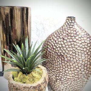 copper vase with plant
