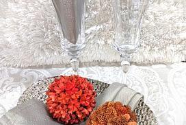 wine with silver napkins and orange balls